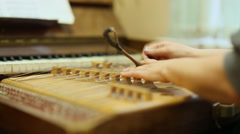 Woman playing the dulcimer in the College of Music - stock footage