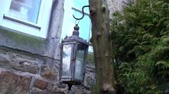 Lantern on wooden pillar in the wind Stock Footage