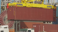 Machinery Handling Cargo Containers - stock footage