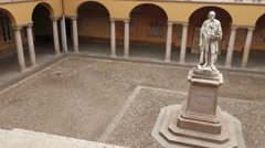 Alessandro Volta statue at University of Pavia, PV, Italy, slow panoramic shot Stock Footage