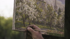 Artist signs his completed picture closeup. Stock Footage