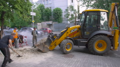 Yellow Excavator on the Sidewalk Stock Footage