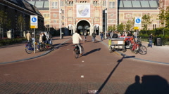Time lapse of Bicyclists & People at the Rijksmuseum Building  - Amsterdam - stock footage