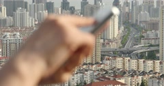 4k human using a smartphone aganist modern urban building background. Stock Footage