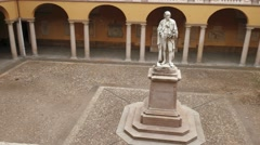 Alessandro Volta statue at University of Pavia, PV, Italy, fast panoramic shot Stock Footage