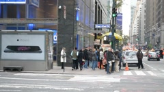 Big City People Waiting At Intersection Crosswalk, and Taxi's Turning The Corner Stock Footage