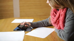 young woman in an office hands writing on paper - stock footage