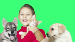 girl and pets on a green screen - stock footage