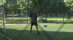 Man playing football at the small stadium  Stock Footage