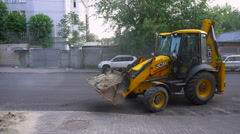 Excavator Travels Backwards Stock Footage