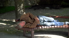 Homeless Man Sleeping on a Bench Stock Footage