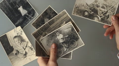 vintage family photos on a table close-up - stock footage