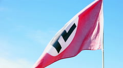 The flag of Nazi Germany develops on the background of blue sky. Stock Footage