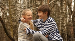 Cute girl and boy  in a birch grove Stock Footage