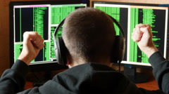 Hacker pleased with victory. Criminal hacker penetrating network system - stock footage