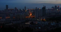 4k busy urban traffic on overpass at night,urban morden building,QingDao china. - stock footage