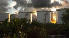 Oil storage tank at sunrise with clouds time lapse, 4K Stock Footage