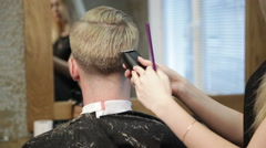 Woman barber  maiking man's haircut Stock Footage