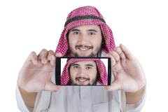 Arabian man taking self photo Stock Photos