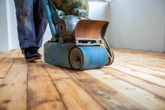 Home renovation, parquet sanding, polishing Stock Photos