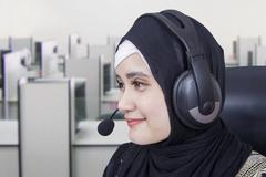 Female hotline operator with headphones Stock Photos