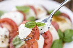Tomatoes with Mozzarella and Balasimco dressing Stock Photos
