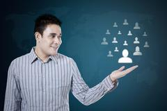 Man showing social media network - stock photo