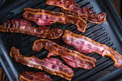 Skillet with fried Bacon Stock Photos