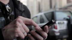 Male Hands Surfing Net On Smartphone - stock footage