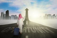 Muslim entrepreneur with opportunity word at road - stock photo