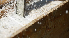 Sawdust fills the air as a carpenter uses a electric powered circular saw to cut Stock Footage