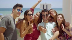 Laughing group of young students at the coast Stock Footage
