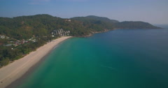 Aerial View of Aqua Colored Sea and Tropical Beach in Phuket Thailand Stock Footage