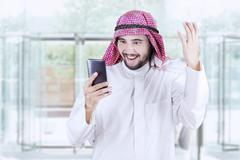 Successful Arabic worker reads message Stock Photos