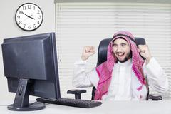 Successful middle eastern worker in office - stock photo