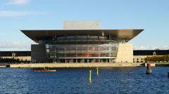 Rowers in front of Copenhagen Opera Theater - Copenhagen Denmark Stock Footage