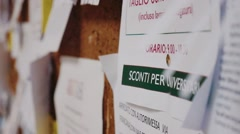 Leaflet on a university bulletin board Stock Footage