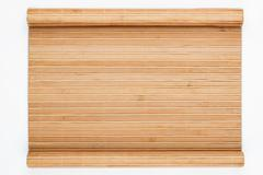 Bamboo mat twisted in the form of a manuscript - stock photo