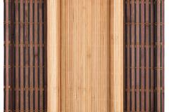 Two bamboo mat twisted in the form of manuscript isolated on white background Stock Photos