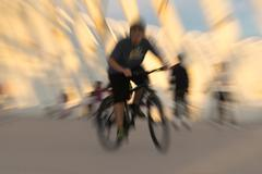 Bicycle rider with a zoom burst effect. - stock photo