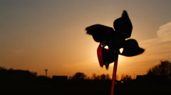 Pinwheel windmill against a sun. Windmill silhouette Stock Footage