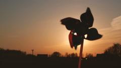 Pinwheel windmill against a sun. Windmill silhouette - stock footage