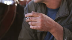 Man hand holding burning cigarette Stock Footage