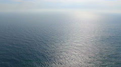 Flying high above the ocean on a bright sunny day Stock Footage