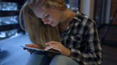 Girl working on digital tablet at home. 4K 30fps ProRes (HQ) Stock Footage