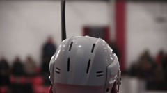 Ice hockey player sitting on the bench, watching match, waiting for instructions Stock Footage