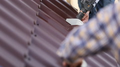 workers install metal roofing - stock footage