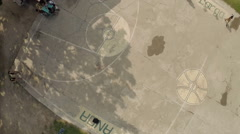 Basketball playground in the Philippine city. Aerial survey Stock Footage