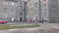 Ghetto in Prerov, Kojetinska street with courtyard Gypsy residents Stock Footage