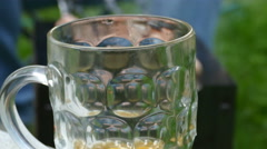 Mug With Pouring Beer on Background Barbecue Fingers Stock Footage